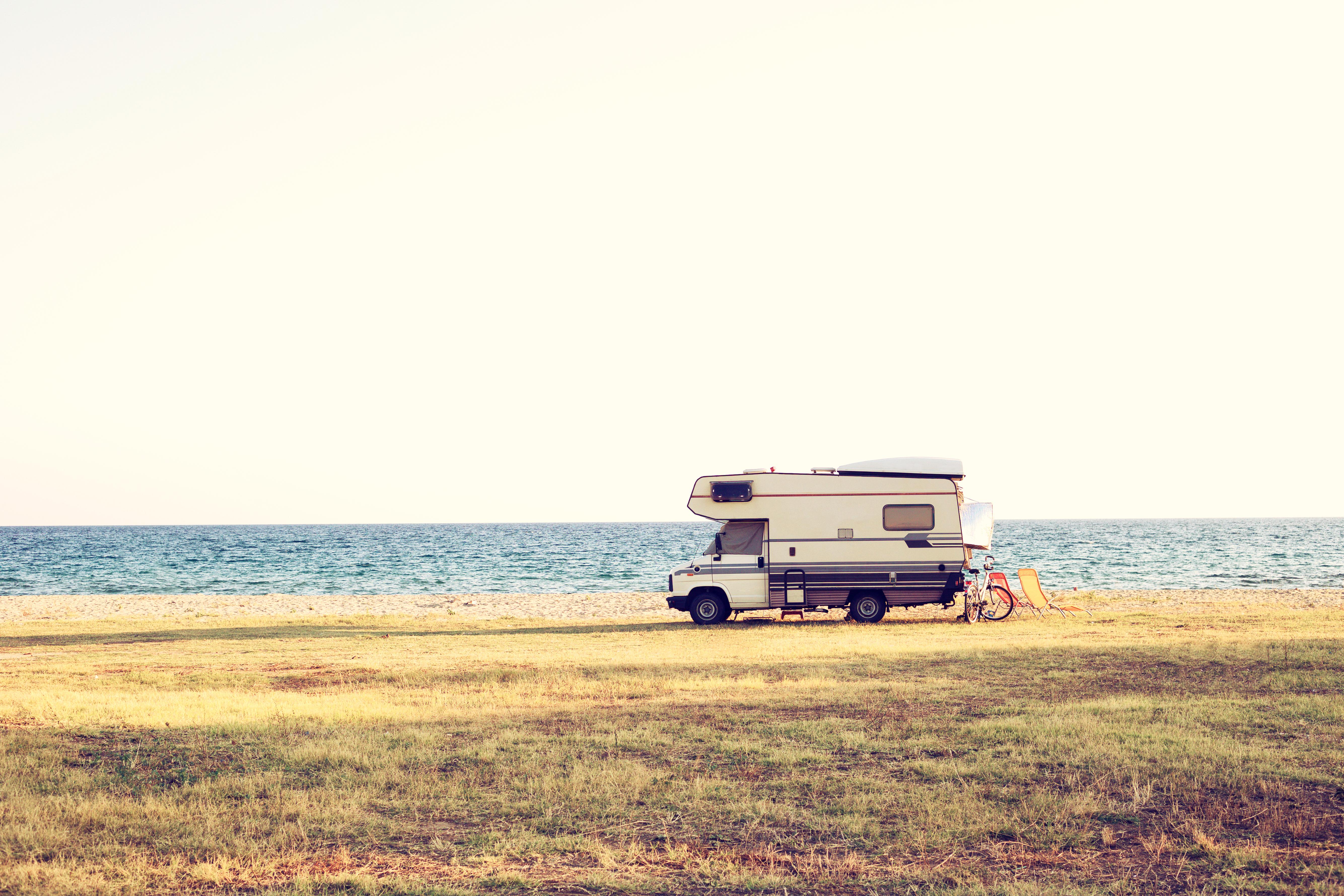 A vintage shoot with a motorhome caravan car near the Mediterranean sea in a beautiful summer day.